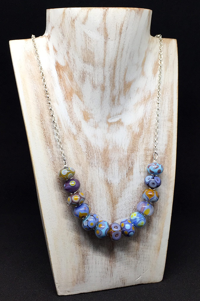 13 Handmade Beads on a Silver Chain