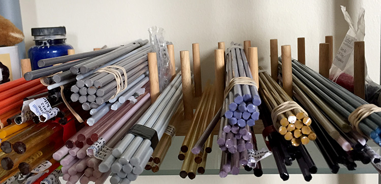 Lampwork glass rods in a pile