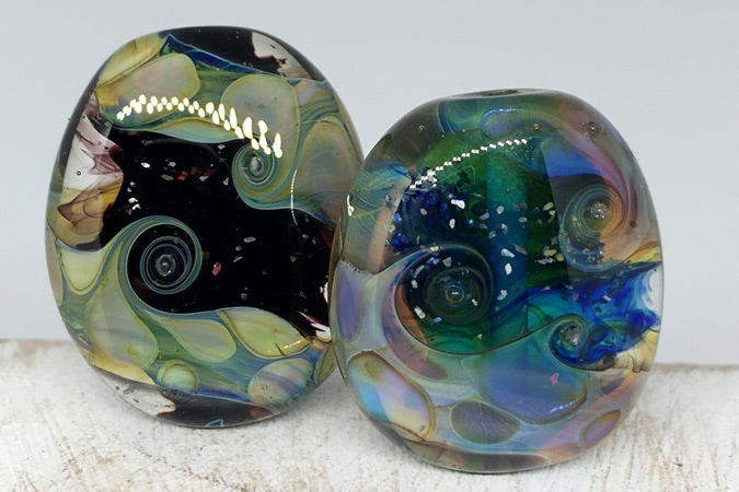 Alternative sides of 2 handmade lampwork glass beads with Double Helix Glass