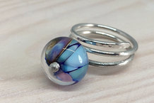 Solid silver ring with glass bead decoration
