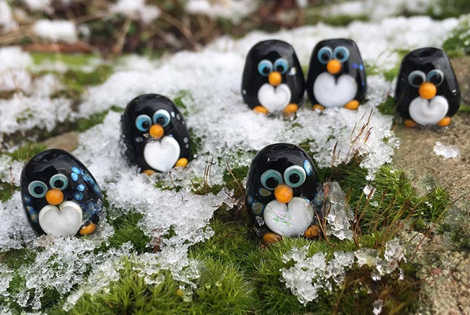 Glass penguins in snow